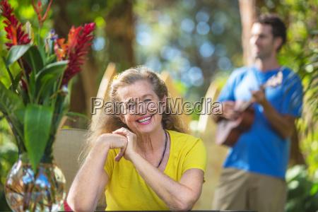 enthusiastic senior woman on vacation
