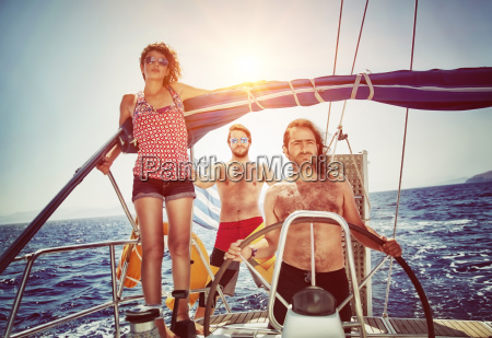happy friends on sailboat