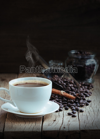 hot coffee and beans on wood
