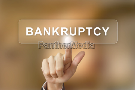 business hand clicking bankruptcy button on