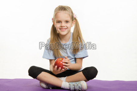 six year old girl sitting on