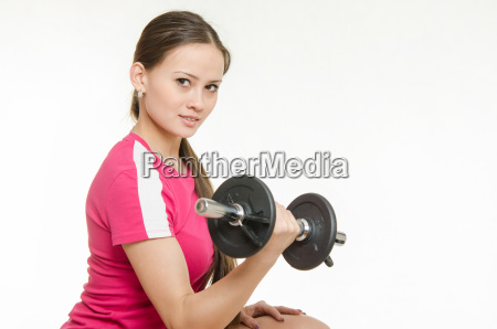athlete swings dumbbells muscles of the