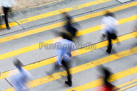 busy crossing street in hong kong