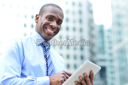 businessman posing with digital tablet