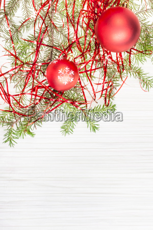 two red xmas balls and tree