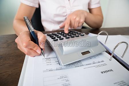 accountant calculating receipt