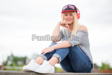 girl with headphones and baseball cap