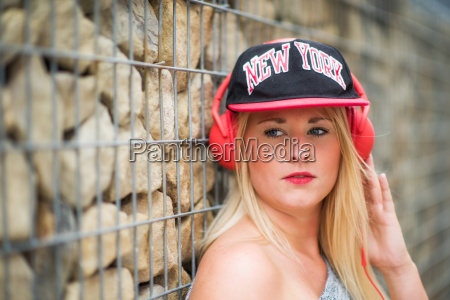 girl with baseball cap standing at