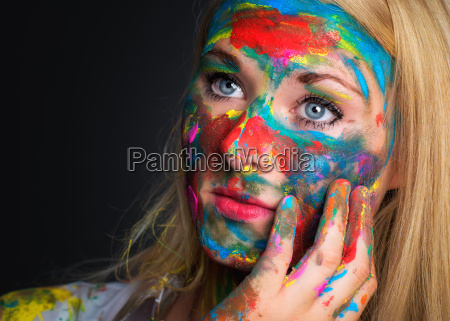 colorful painted pensive woman face f