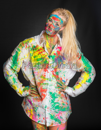 blonde girl is painted with finger