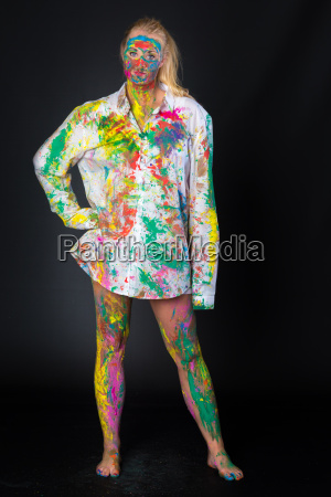 young woman is brightly painted in