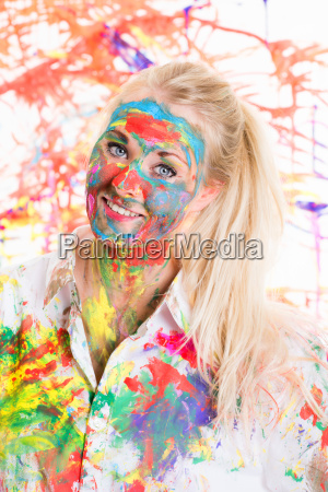 young blonde woman is colorfully painted
