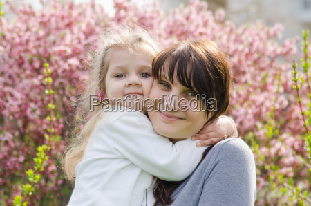 embraces of mother and daughter on