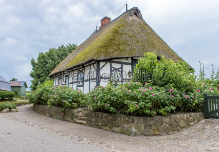 old half timbered house with thatched