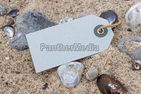 pendants stones and shells in beach
