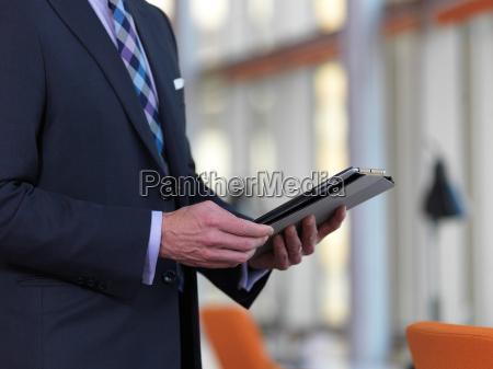 senior business man working on tablet