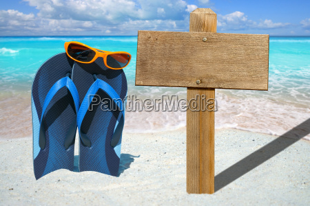 flip flops with sunglasses and wooden