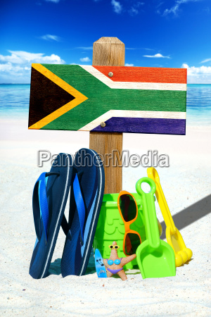 wooden sign with south africa flag