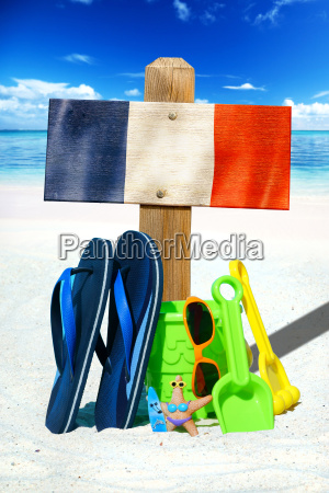 wooden sign with france flag on