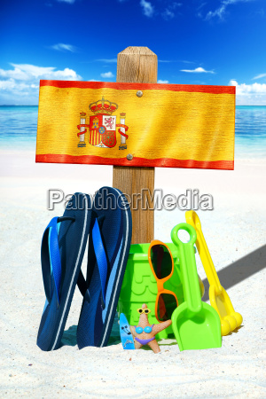 wooden sign with spain flag on