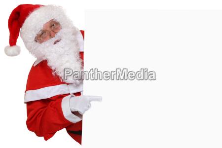 weihnachtsmann nikolaus zeigt an weihnachten auf