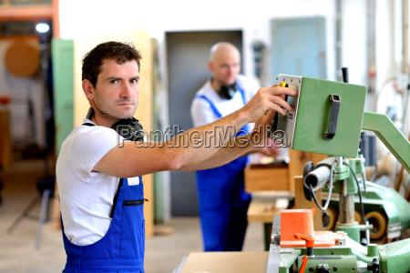 worker in factory using machine