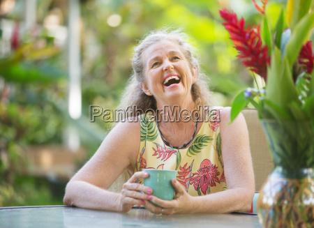joyful senior woman laughing