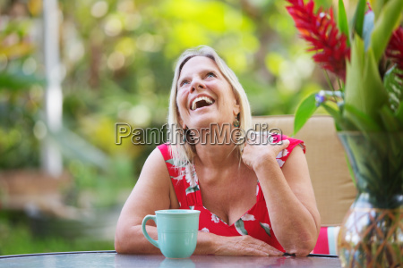 laughing woman sitting at table