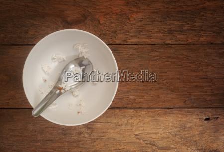 white ceramic bowl on wood background