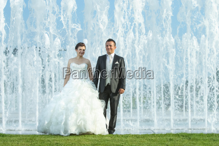 bride and groom in front of