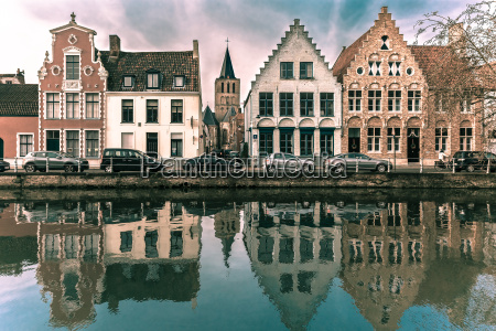 scenic bruges canal with beautiful houses