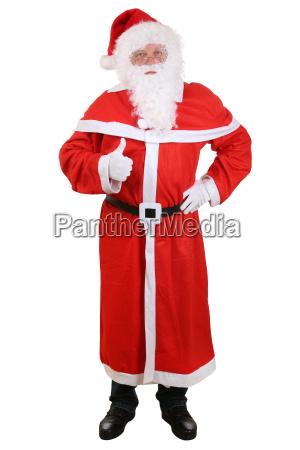 weihnachtsmann nikolaus an weihnachten ganzkoerper daumen