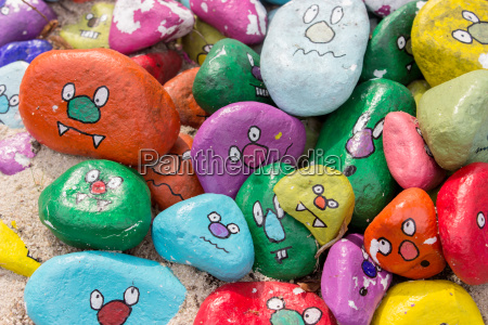 painted stones with faces