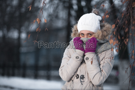 cheerful woman clothing in warm hat