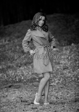 beautiful young woman in brown raincoat