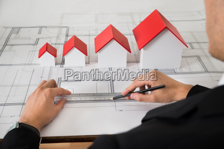 architect with different size house models