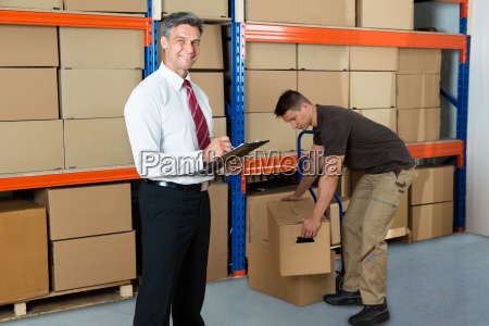 manager with clipboard and worker in