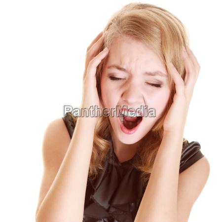 businesswoman with headache head pain screaming