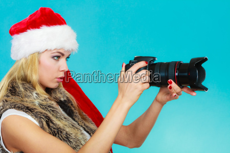 photographer girl in santa claus hat