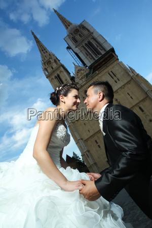 groom on knees before bride