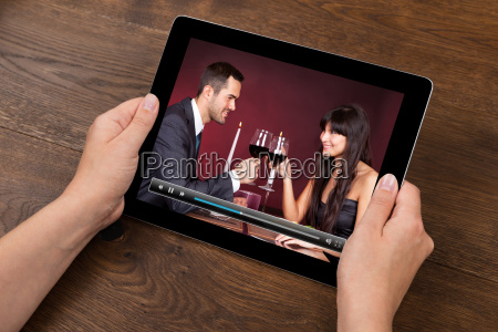 person hands with digital tablet showing