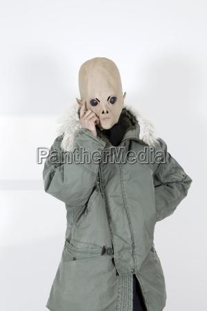 alien wearing a military coat