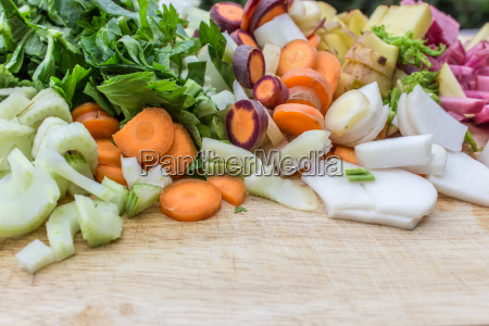 fresh cut vegetables on a wooden