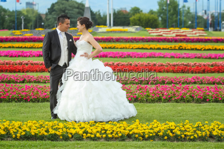 bride and groom standing on lawn