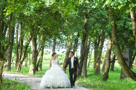 newlyweds walking in nature