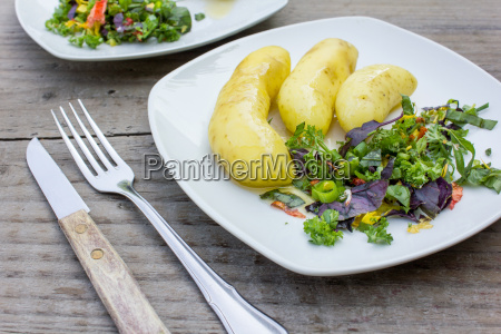 boiled potatoes with butter and colorful