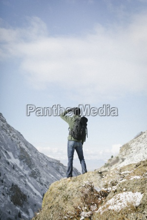 a man hiking in the mountains