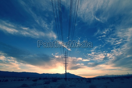 power lines on poles reaching into