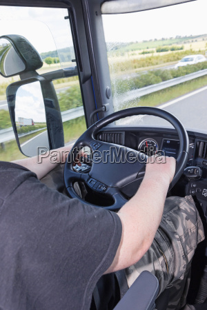 vertically photo of the driving truck