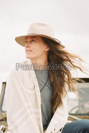woman wearing a hat sitting on